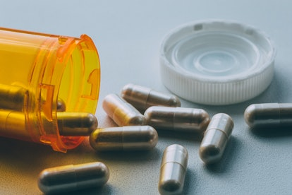 """A bottle with antibiotics on a table. If you're asking """"Why am I passing gas so much?"""" looking at your antibiotic regimen can help source answers."""