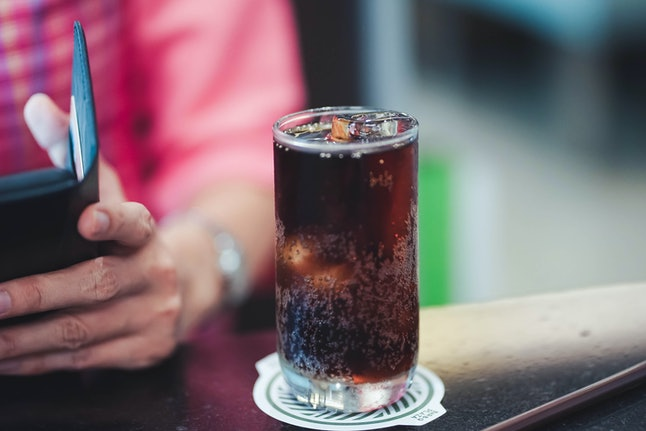 A soda with ice. Ingesting too much air can lead to passing gas too much