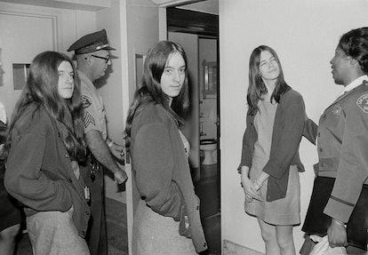 Leslie Van Houten, Susan Atkins, Patricia Krenwinkel Dressed in jail denims, three women who are co-...