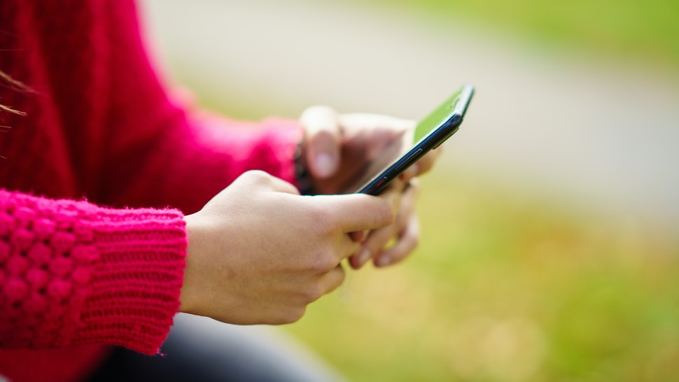 woman texting a message