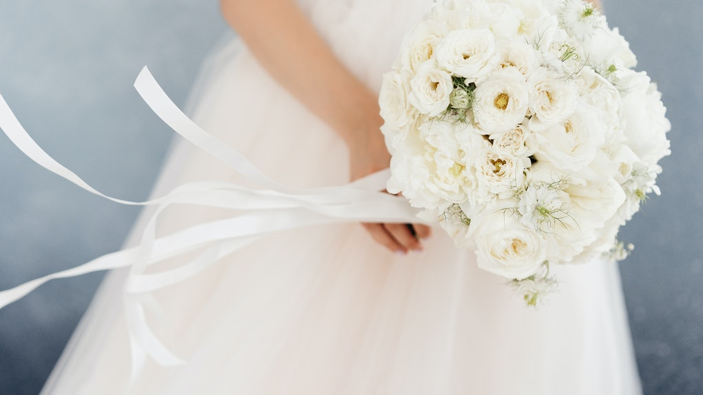 white bride's bouquet in the hands of the bride
