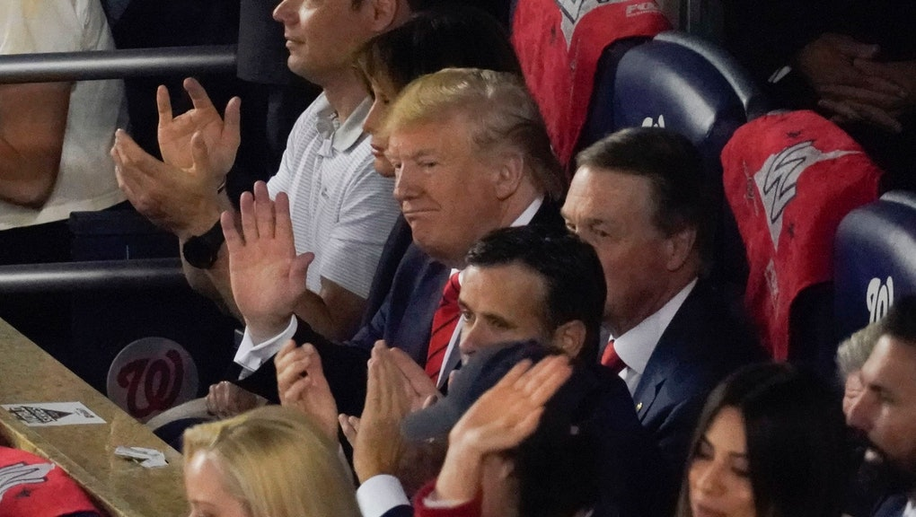 President Donald Trump watches during the first inning of Game 5 of the baseball World Series between the Houston Astros and the Washington Nationals, in Washington