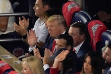 President Donald Trump watches during the first inning of Game 5 of the baseball World Series betwee...