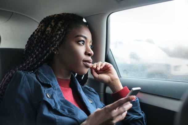 Black girl thinking on the backseat