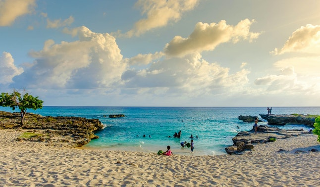 Grand Cayman, Cayman Islands, July 2017, Smith's Barcadere beach also known as Smith Cove in the South Sound at sunset