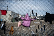 Clothes which belong to refugees drying on a fence, right on the borderline that splits Greece from ...