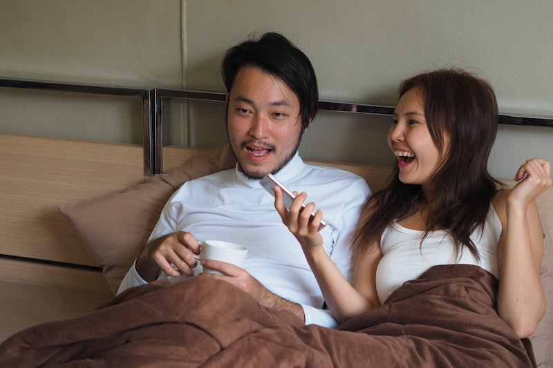 Couple lover talking together in bedroom.