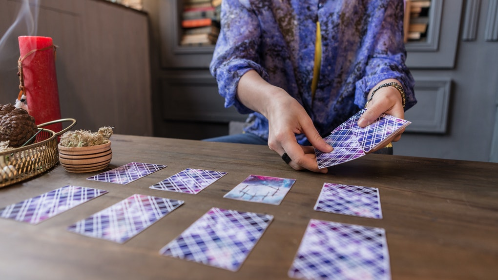 Close up of tarot cards in hands