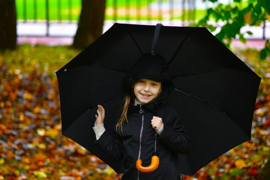child with umbrella autumn portrait