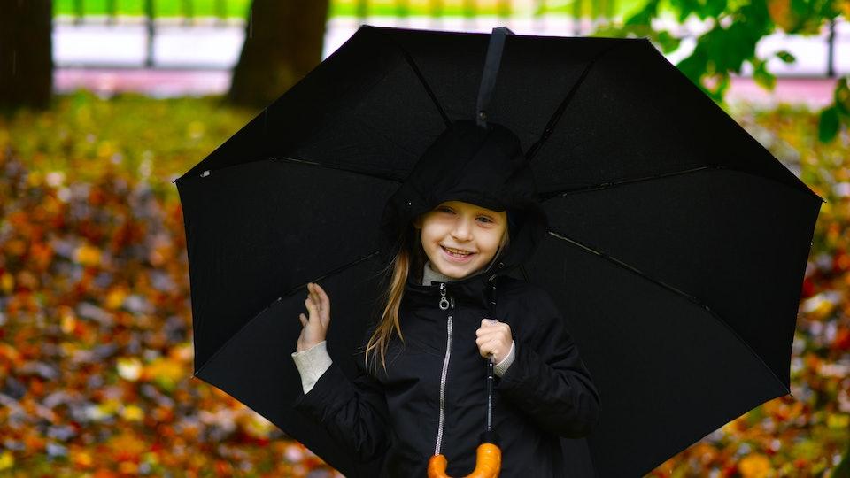 child with umbrella autumn portrait