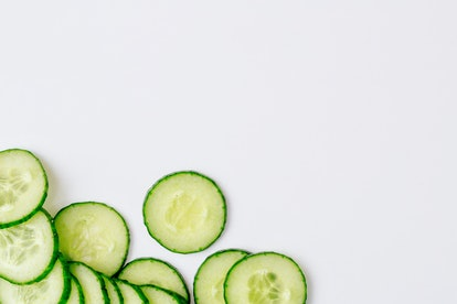 Fresh cucumber slices on a white background. Copy space.