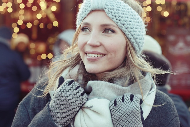 There are many ways to pack light for a winter trip, and bringing a few different hats can help switch up your look.