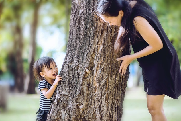 Recreation and development childhood with parental activity concept, Asian mom chasing a little girl...