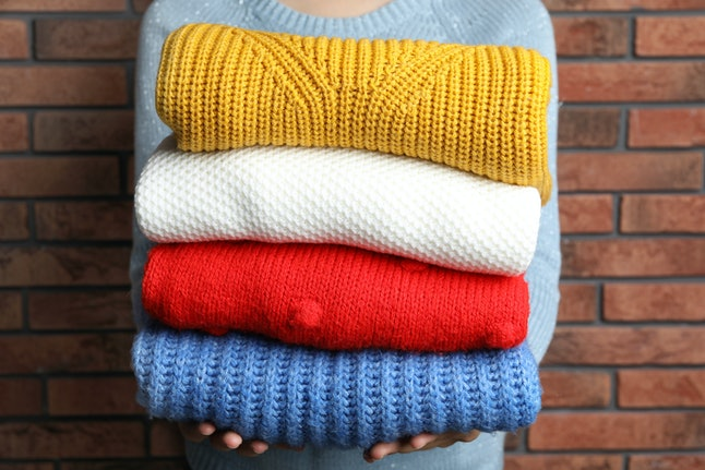 There are many ways to pack light in the winter, and using bulky clothing items as buffers will help.
