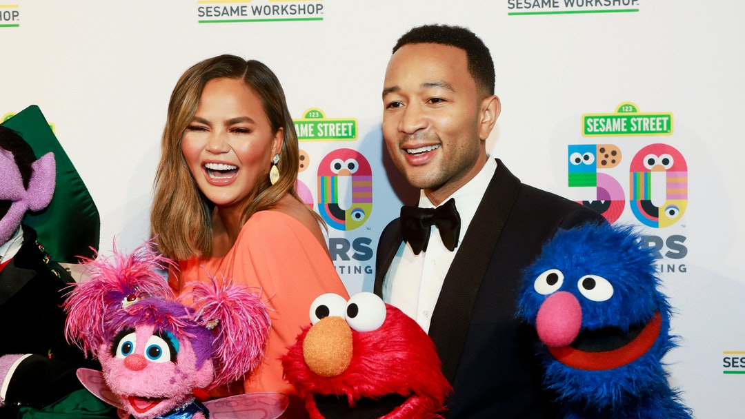 Chrissy Teigen, John Legend. Chrissy Teigen, left, and John Legend, right, attend the Sesame Workshop's 50th anniversary benefit gala at Cipriani Wall Street, in New York