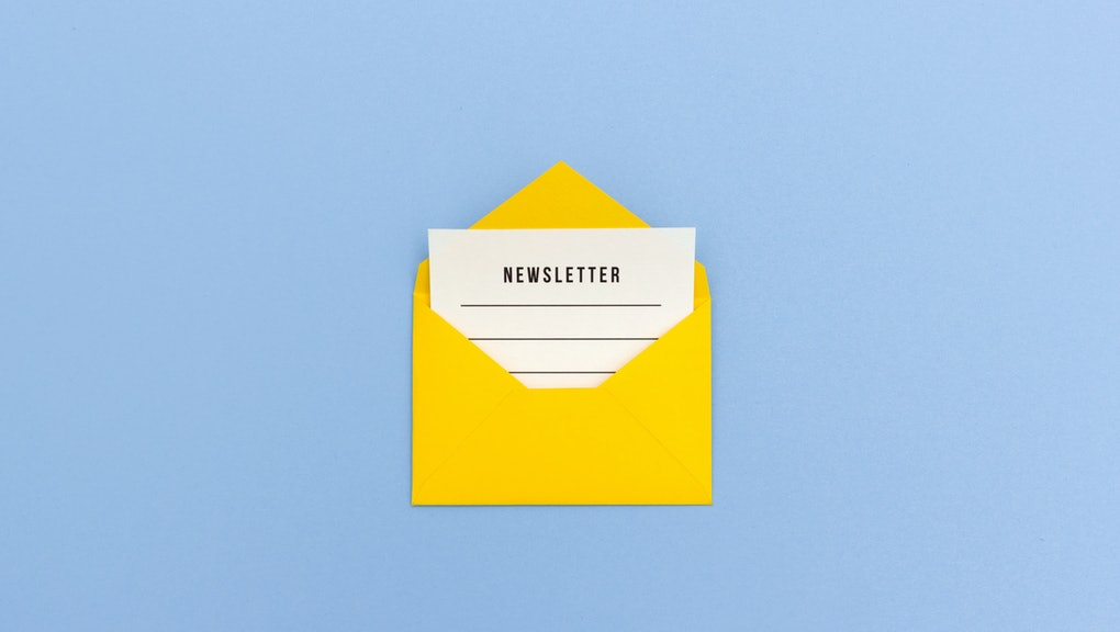Newsletter concept - Newsletter page looking out of yellow paper envelope