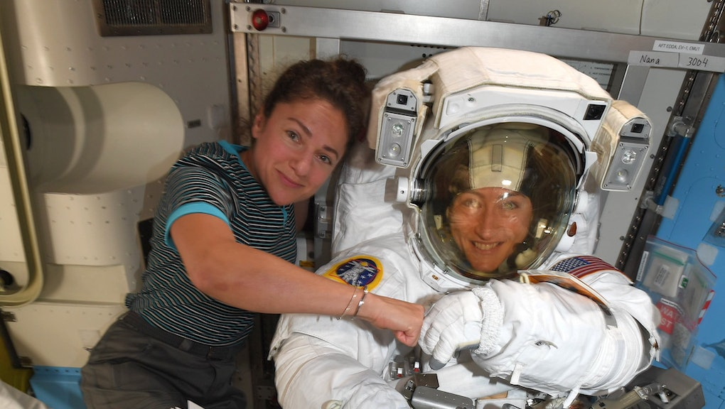 A handout photo released by NASA on 04 October 2019 shows astronauts Jessica Meir (L) and Christina ...
