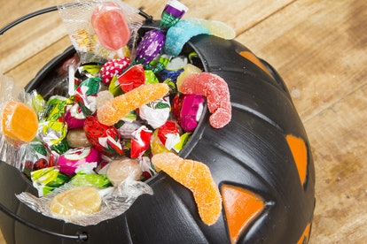 Experts say avoiding Halloween candy completely can cause your children to want it more — moderation...