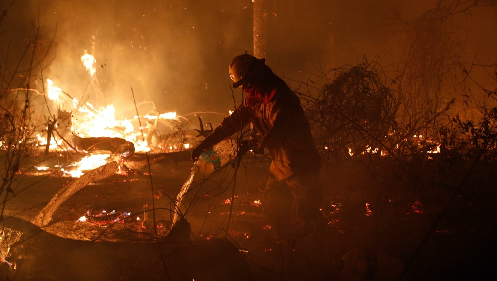 A marine works to put out a fire in the Chiquitania Forest in Santa Rosa de Tucabaca, on the outskirts of Robore, Bolivia, . While some of the fires are burning in Bolivia's share of the Amazon, the largest blazes were in the Chiquitanía region of southeastern Bolivia. It's zone of dry forest, farmland and open prairies that has seen an expansion of farming and ranching in recent years