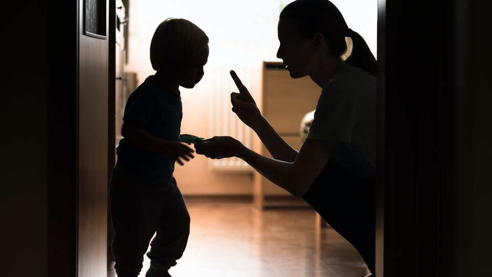 Mom disciplining her child. Teaching-parenting your kid concept.