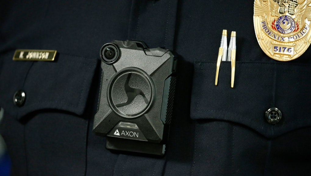 Phoenix Police Department Sgt. Kevin Johnson shows off the new Axon Body 2 body camera as another precinct gets their cameras assigned to them, in Phoenix. Although body-worn cameras are becoming a police standard nationwide, Phoenix was among the last big departments to adopt their widespread use