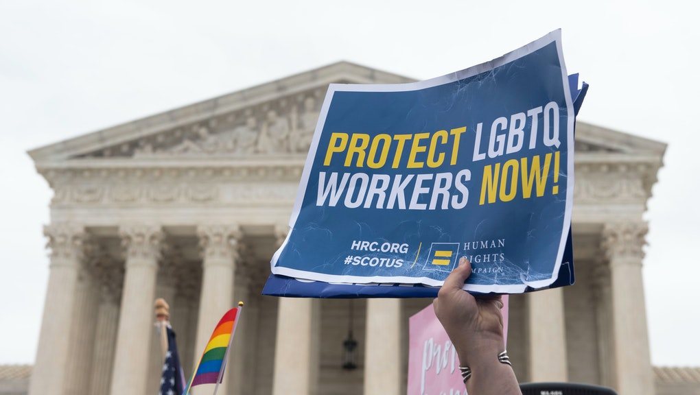 Human Rights Campaign supporter takes part in a rally outside the Supreme Court during oral arguments on non-discrimination protections for LGBTQ workers on Tuesday Oct.12, 2019 in Washington