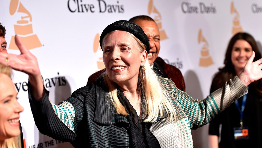 Joni Mitchell arrives at the 2015 Clive Davis Pre-Grammy Gala at the Beverly Hilton Hotel in Beverly Hills, Calif. Mitchell was hospitalized in Los Angeles on according to the Twitter account and website of the folk singer and Rock and Roll Hall of Famer, but details on her condition have not been released