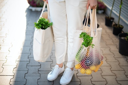 Experts recommend washing your reusable shopping bags at least every two weeks so they aren't transm...