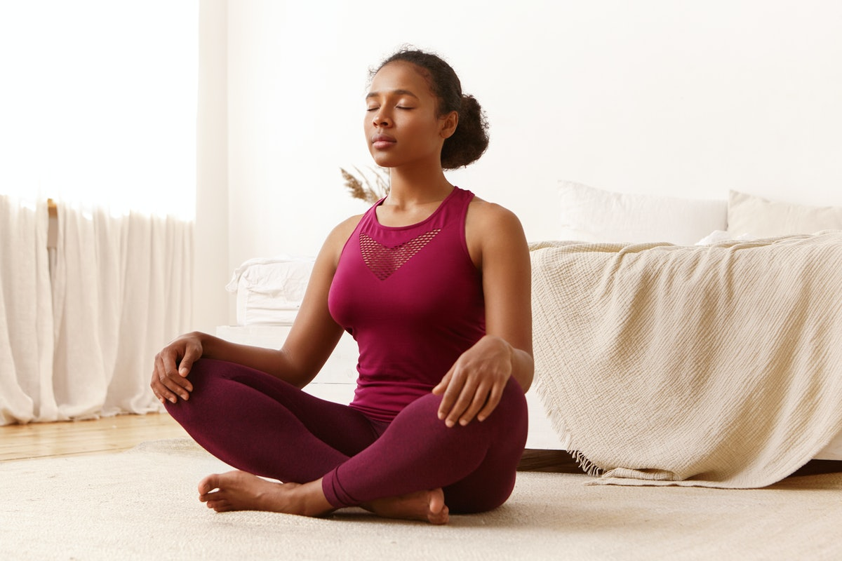 Health, active lifestyle, well being and people concept. Portrait of attractive peaceful young black...