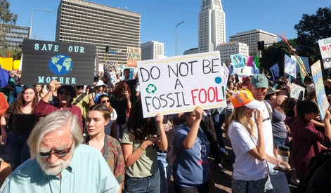Climate activists participate in a student-led climate change march in Los Angeles on