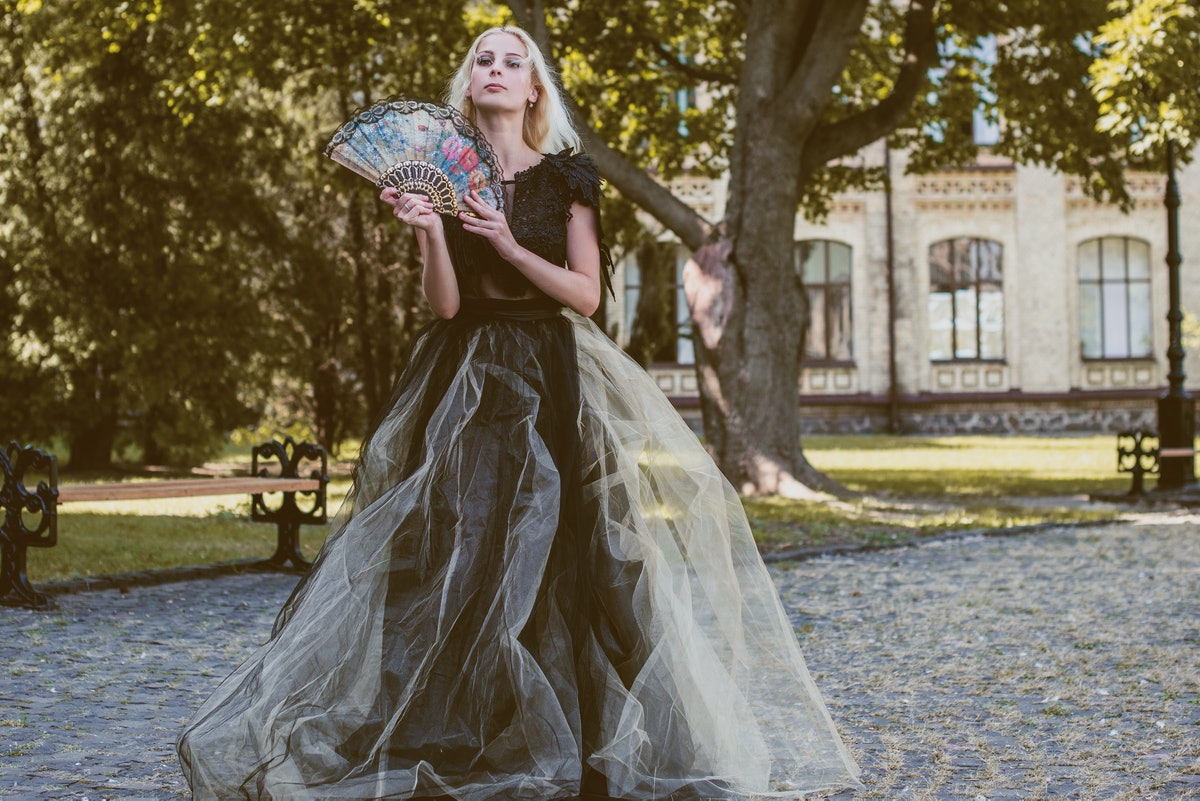 Halloween party concept, mysterious girl in black lace handmade dress . Beautiful young woman. Inspi...