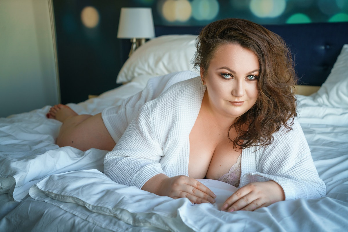 sexy fat woman seduces on the bed.