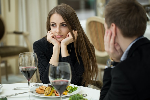 Young woman annoyed at Thanksgiving dinner