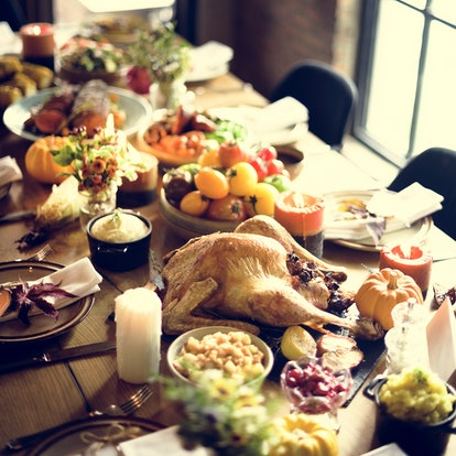 Thanksgiving dinner spread with turkey, cranberry sauce, stuffing, and more