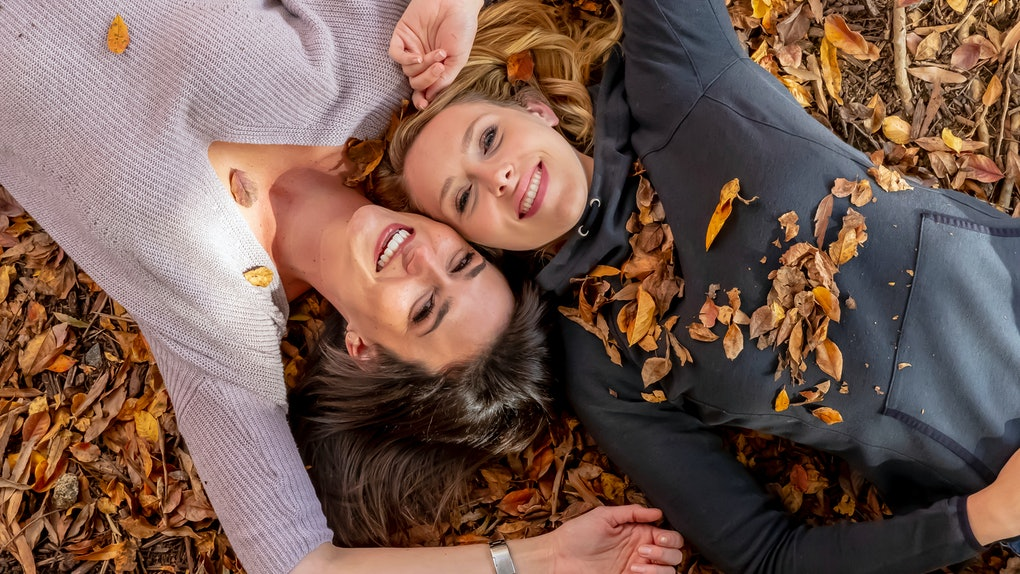 Two gorgeous models enjoying each others company on a fall day