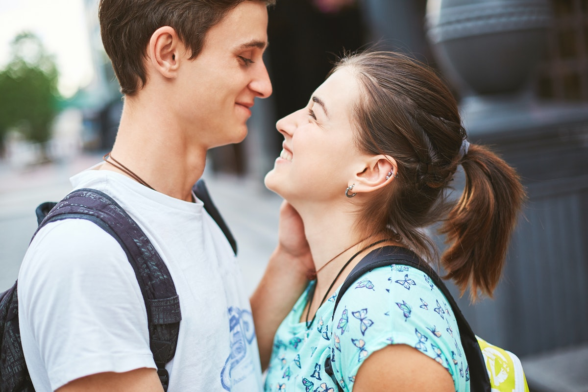 Young people, couple having date on the street. A loving couple on a date on a summer evening. The g...