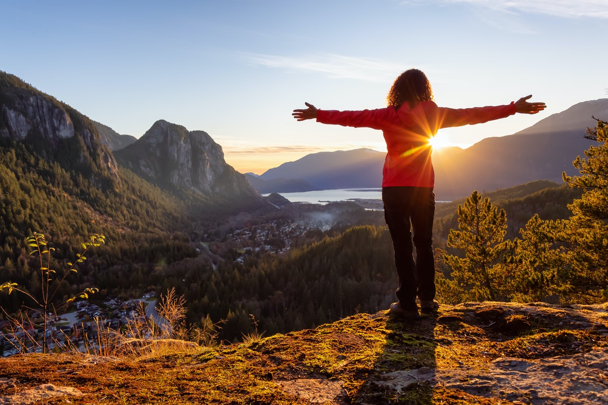 Adventurous Girl Hiking in the mountains during a sunny Autumn Sunset. Taken Squamish, North of Vanc...