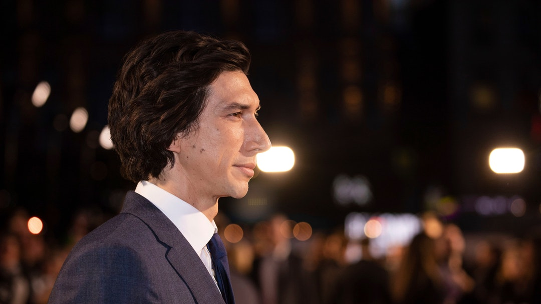 Adam Driver poses for photographers upon arrival at the premiere of the film 'Marriage Story' which is screened as part of the London Film Festival, in central London