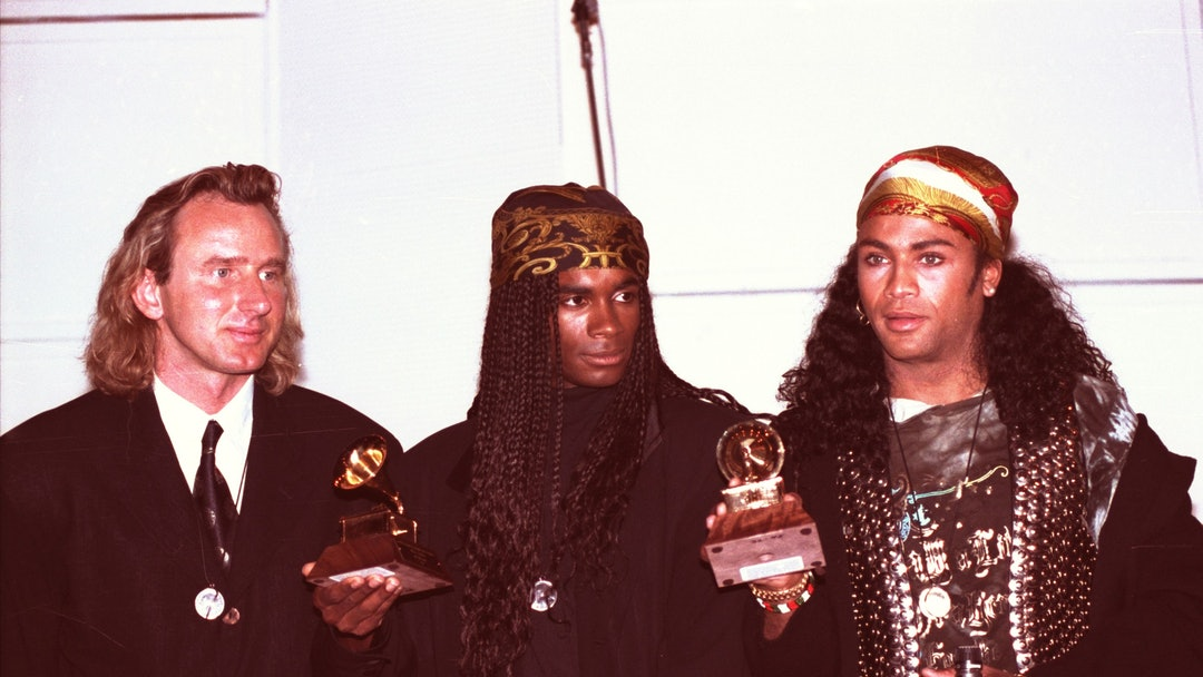 Milli Vanilli Fab Morvan, left, and Rob Pilatus of Milli Vanilli hold up their Grammys for Best New Artists of 1989 during a news conference in Hollywood. The pair was stripped of the award when it was revealed that they did not sing a note on their hit album, and lip-synched their public appearances