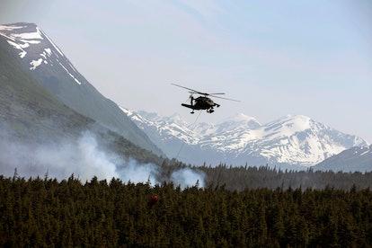 Alaska Army National Guard Black Hawk crews help fight Alaska fires. From the Alaska Army National G...