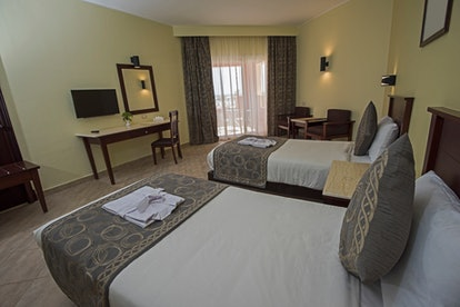 Some couples prefer to sleep in separate beds only while away on vacation.
