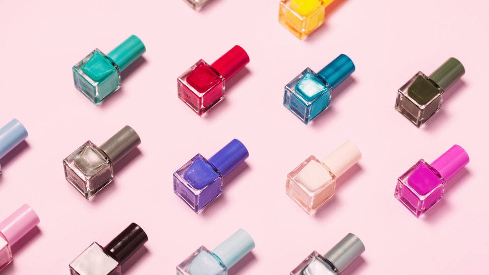 Colorful Nail polish bottles pattern background. Close up.