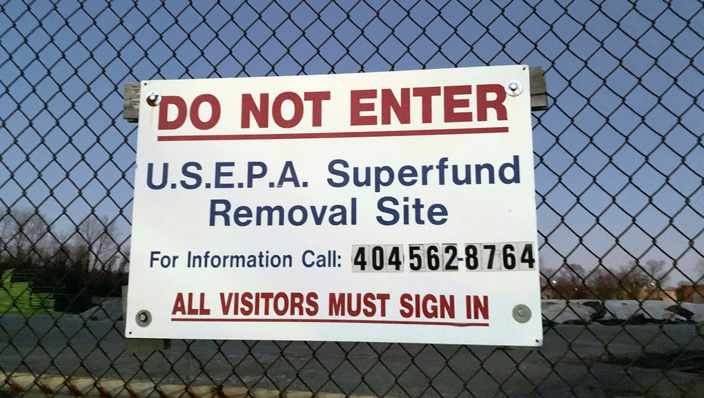 """A sign identifies the Superfund removal site on the property of a former high school in Birmingham, Ala., . Last User: APGBL\amthomas The partial government shutdown has forced suspension of federal work at the nation's Superfund sites unless it is determined there is an """"imminent threat"""" to life or property"""