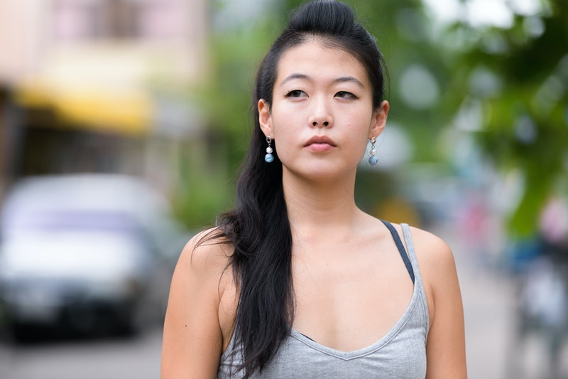 Face of beautiful Asian woman thinking and looking away