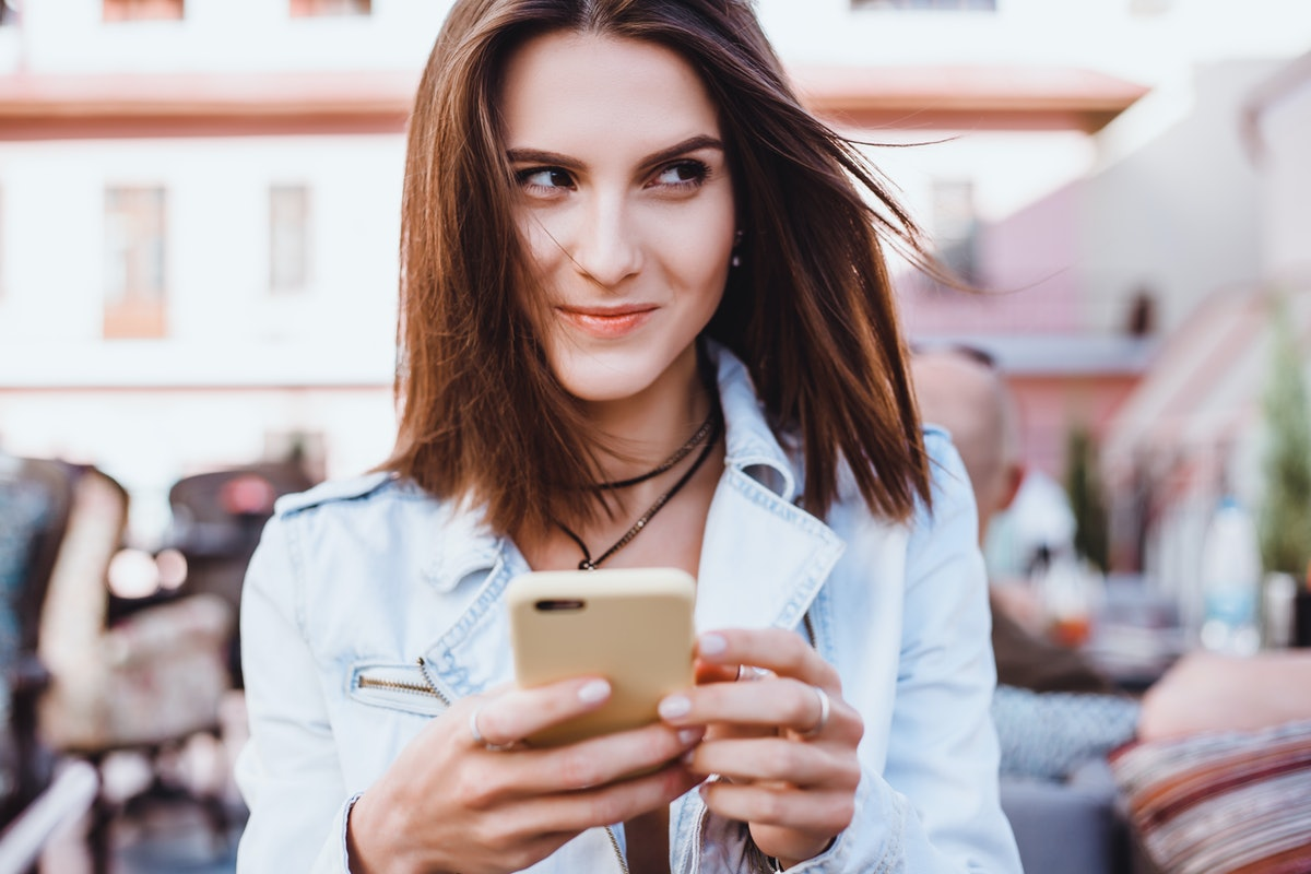 young pretty woman posing in the street with phone, outdoor portrait, hipster girls, sisters, chic, tablet, internet, using smartphone, close-up fashion model, post in instagram, facebook. street