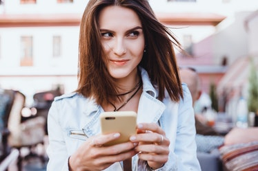 young pretty woman posing in the street with phone, outdoor portrait, hipster girls, sisters, chic, ...