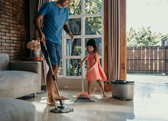 little girl help her daddy to do chores at home