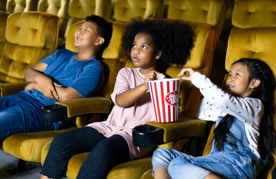 A group of kids watching a movie in a theatre