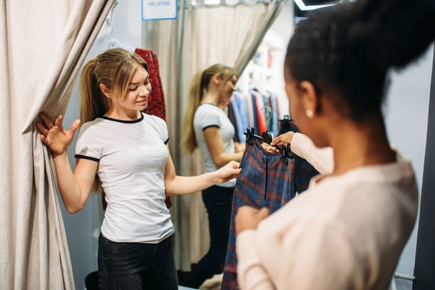 Two women in the dressing room, shopping