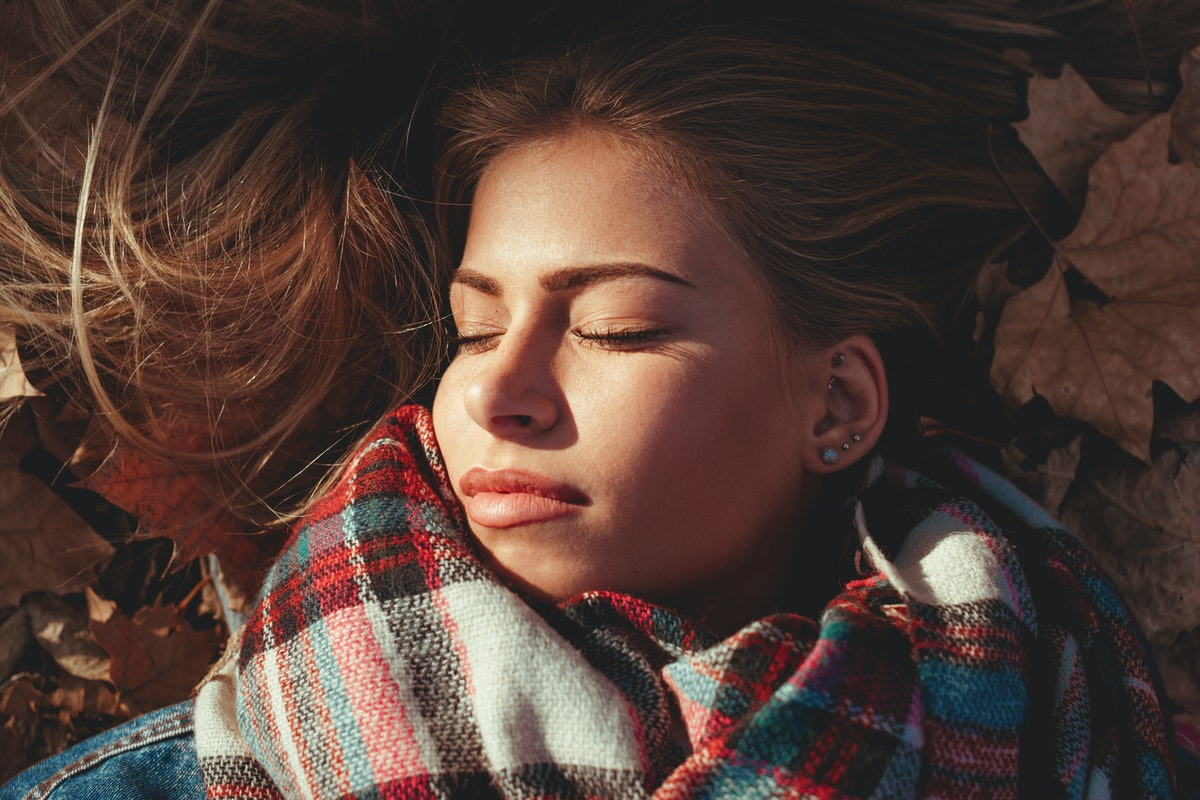 Young woman lying down in the park